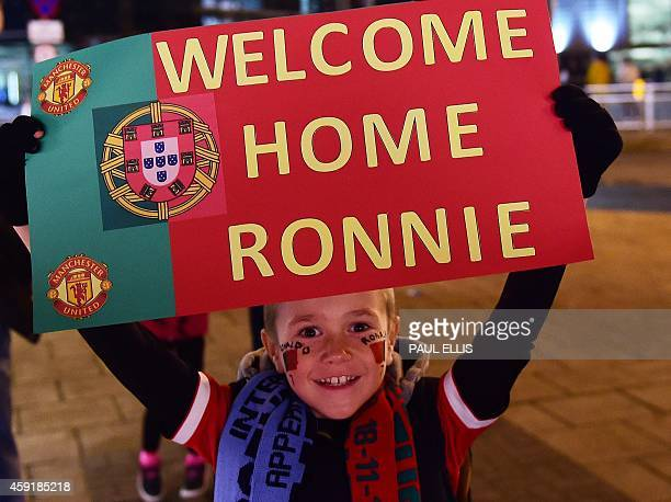 A boy holds a sign welcoming former Manchester United player Portugal's striker Cristiano Ronaldo ahead of the international friendly football match...
