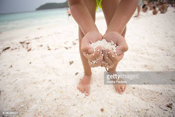 boy holds sand in the form of heart - thasos stock photos and pictures