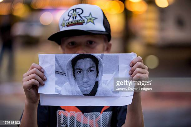 Boy holds up a picture of Trayvon Martin during a protest in Seattle, WA following the 'not guilty' verdict in the murder trial of George Zimmerman...