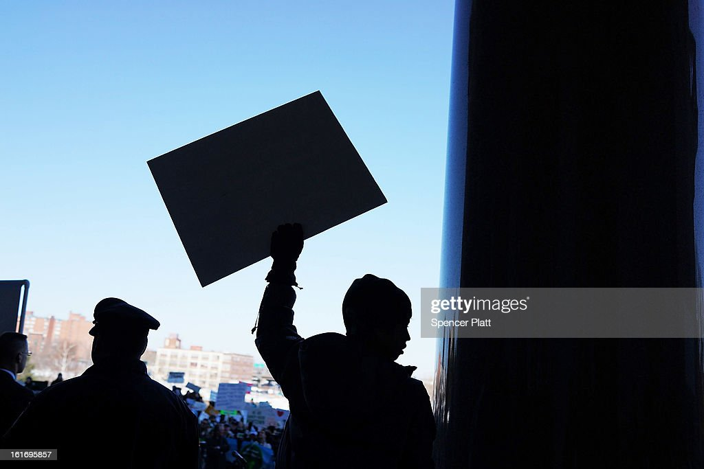 A boy holds up a sign at a rally at the Connecticut State Capital to promote gun control legislation in the wake of the December 14, 2012, school shooting in Newtown on February 14, 2013 in Hartford, Connecticut. Referred to as the 'March for Change' and held on the two-month anniversary of the massacre in Newtown, Connecticut, participants called for improved gun safety laws. Among the safety measures being demanded are for universal background checks, more work within the mental health community and restricting high-capacity magazines.