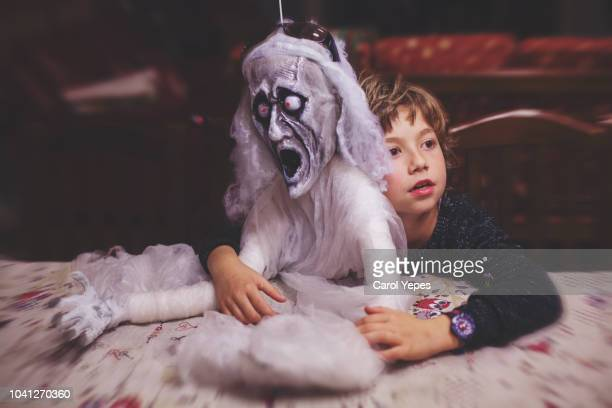 boy hugging a ghost during halloween party