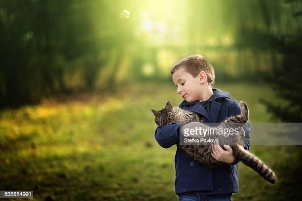Boy hugging cat