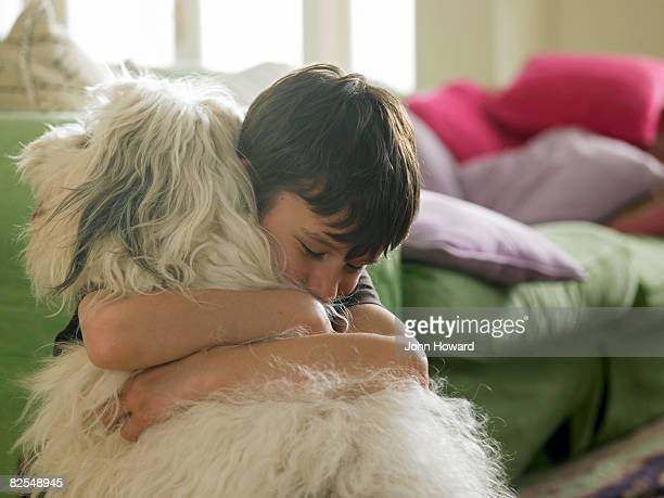 boy hugging his dog - love emotion stock pictures, royalty-free photos & images