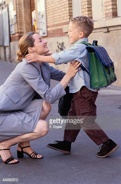 Boy Hugging His Mother Before Going to School