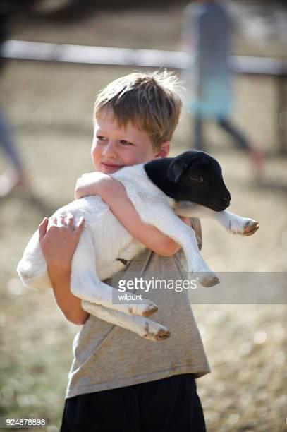 Boy Hugging Lamb