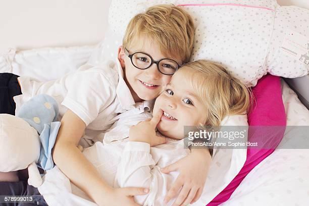Boy hugging little sister