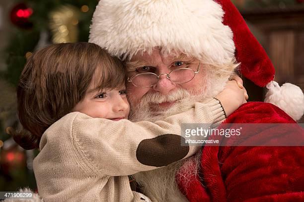 Menino agarrar Real Pai Natal