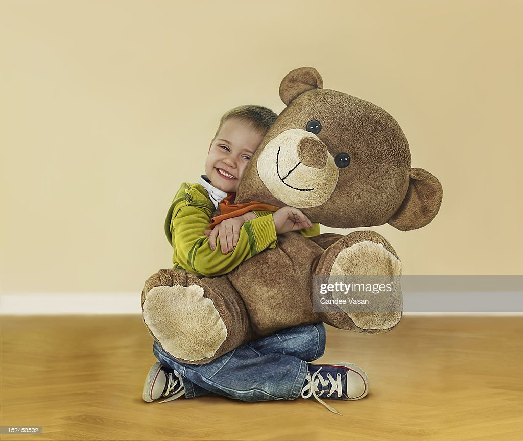 Boy Hugging Teddy Bear : Stock Photo