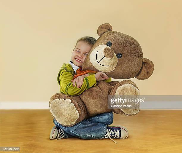 Boy Hugging Teddy Bear