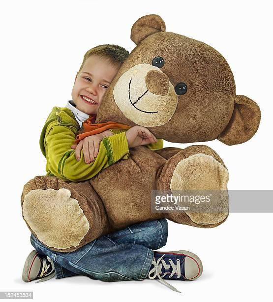 Boy Hugging Teddy Bear