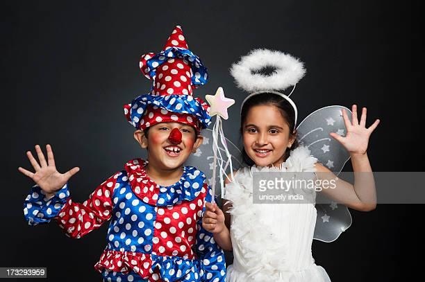 Boy imitating like a clown and girl imitating like a fairy