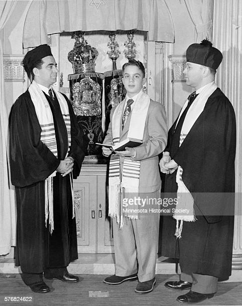 A boy in a bar mitzvah at Adath Jeshuran attended by Rabbi Morris Garden and Cantor Morris Amsel