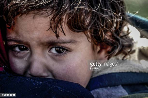 A boy in a camp for internally displaced near Mosul Iraq on March 26 2017 Iraqi forces renewed their assault against the jihadists in Mosul's Old...