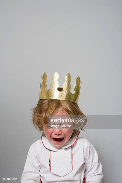 boy in a party hat having a tantrum  - happybirthdaycrown stock pictures, royalty-free photos & images