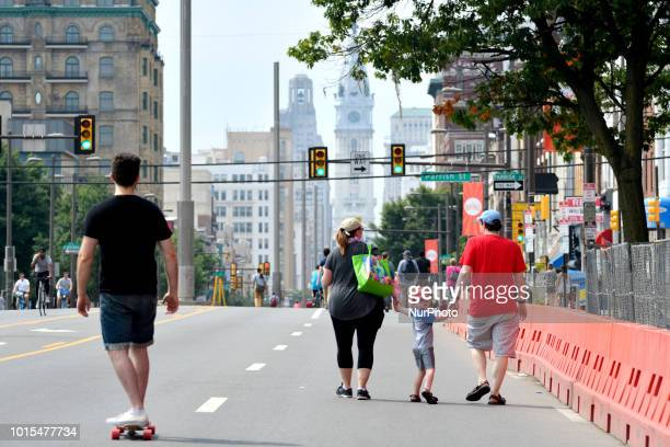 A boy in a Phillies cap looks over his shoulder as thousands of pedestrians cyclist skaters joggers enjoy a closed off 4mi section of North Broad...