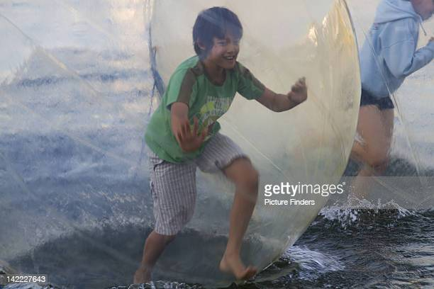 boy in a plastic bubble - people inside bubbles stock pictures, royalty-free photos & images