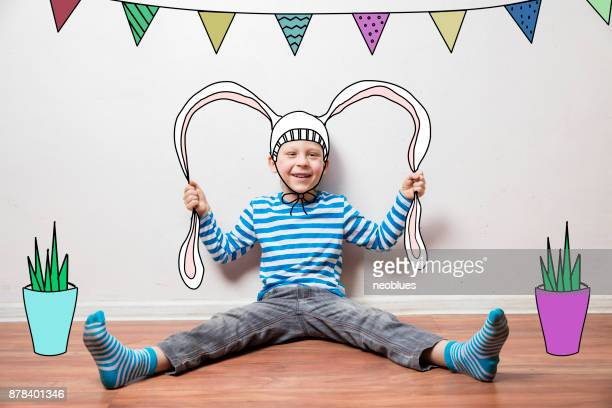 Boy in a rabbit costume, pulls his ears