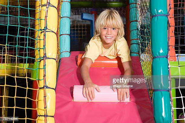Boy in a soft play area