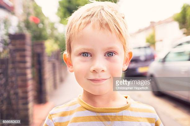 boy in a suburban street - shorthair stock pictures, royalty-free photos & images