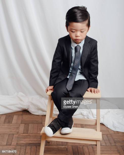 A boy in a suit