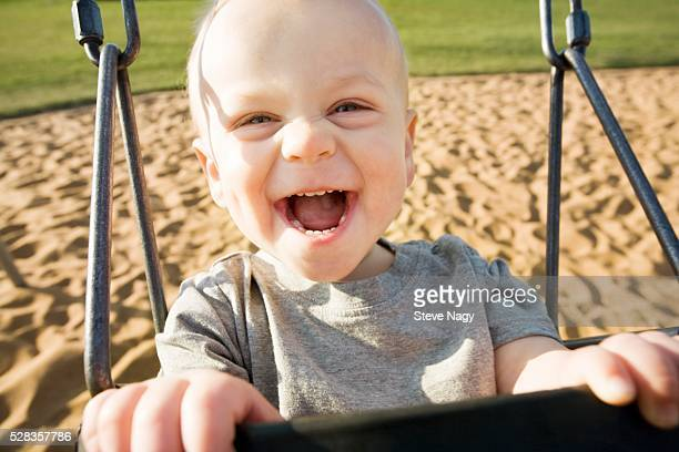 boy in a swing - human joint stock pictures, royalty-free photos & images