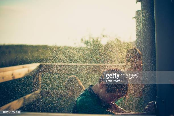 a boy in an outdoor shower. - boys taking a shower stock pictures, royalty-free photos & images