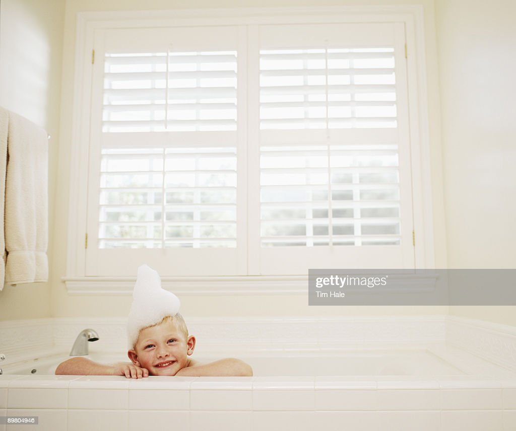 Boy In Bathtub With Bubbles On Head Stock Photo   Getty Images