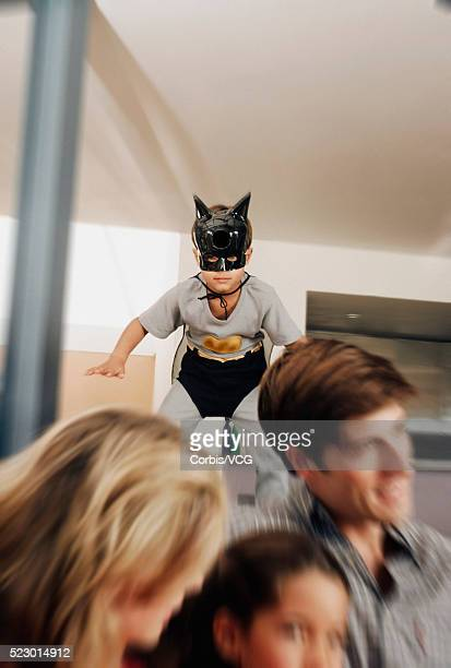 Boy in Batman Costume with Family