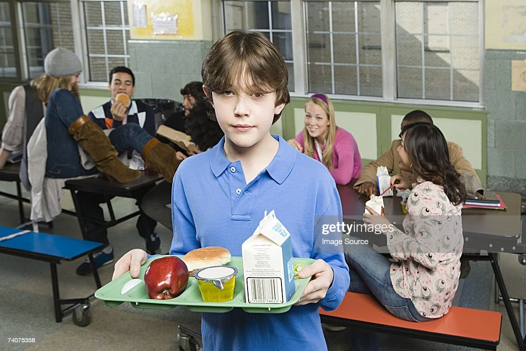 Boy in cafeteria : Stock Photo
