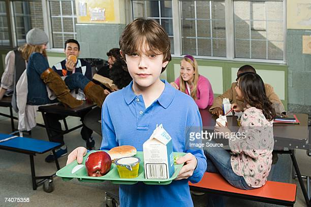 boy in cafeteria - milk carton stock photos and pictures