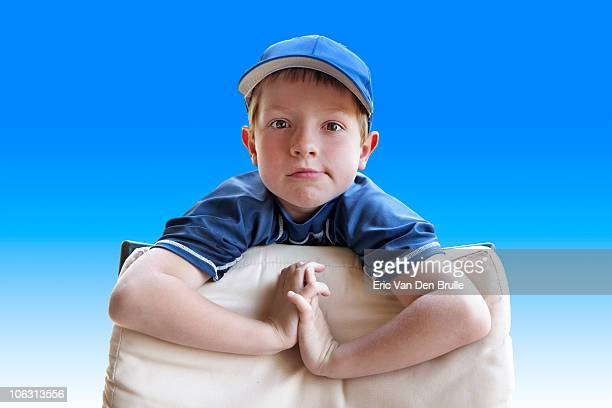 boy in cap with blue background - eric van den brulle stockfoto's en -beelden