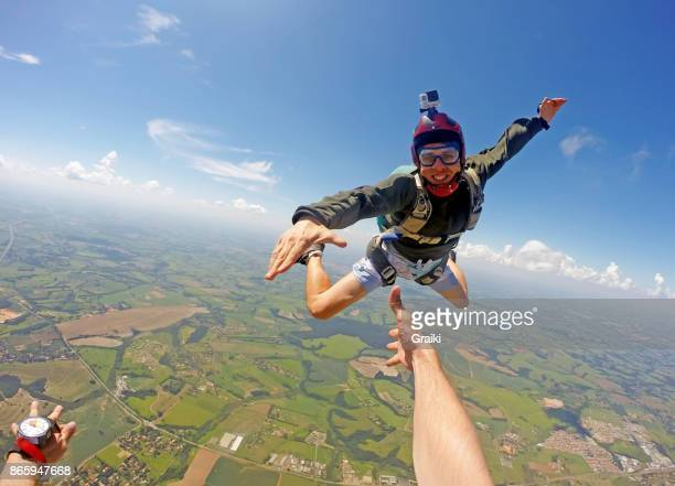 boy in casual clothes jumping from parachute. - brazilian men stock photos and pictures