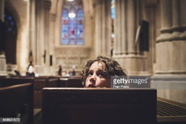 a boy in church. - religion stock pictures, royalty-free photos & images