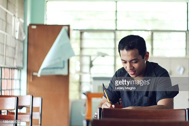 boy in classroom at school - philippines stock pictures, royalty-free photos & images