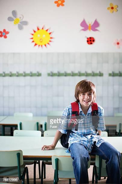 Boy in Classroom Wearing Backpack