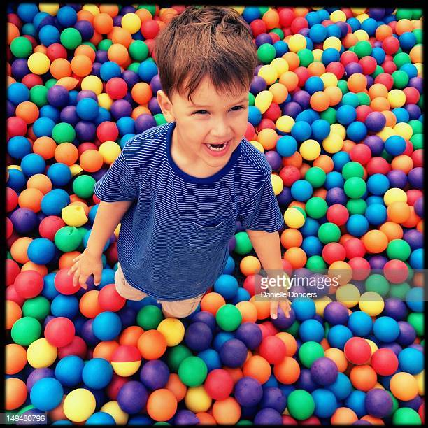 Boy in colorful balls