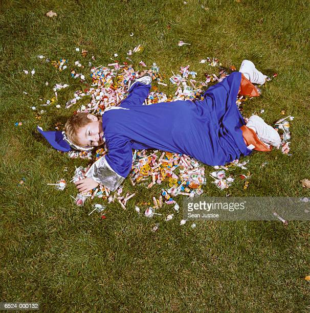 Boy in Costume Lying on Candy