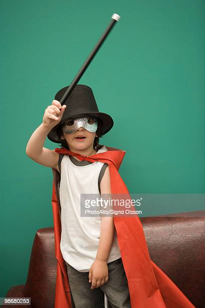 Boy in costume pretending to be magician