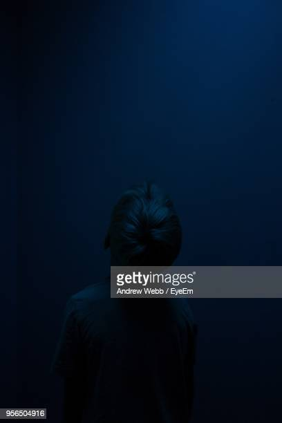 Boy In Dark At Night