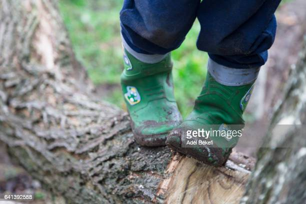 Boy in dirty rubber boots