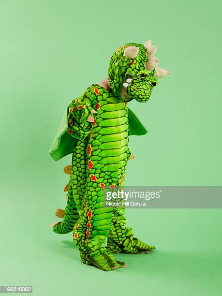 Boy (2-3) in dragon costume for Halloween