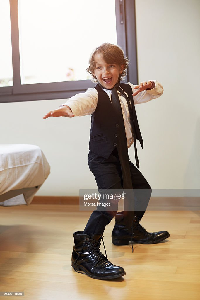 Boy in formal wear posing at home : Stock Photo