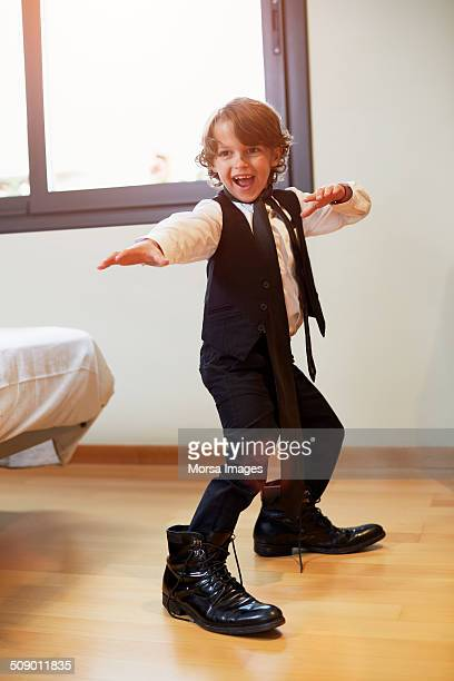 Boy in formal wear posing at home