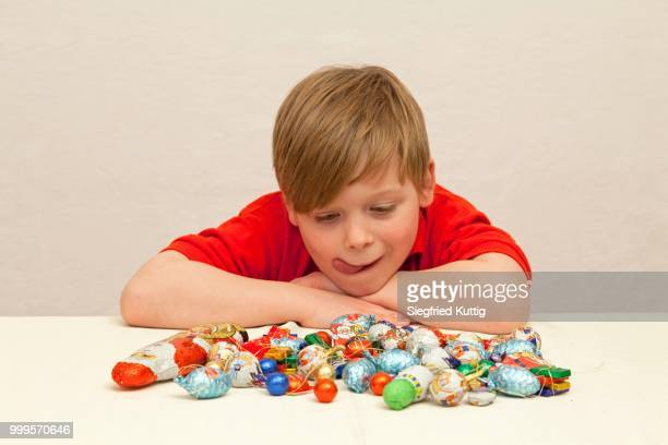 Boy in front of Christmas candies