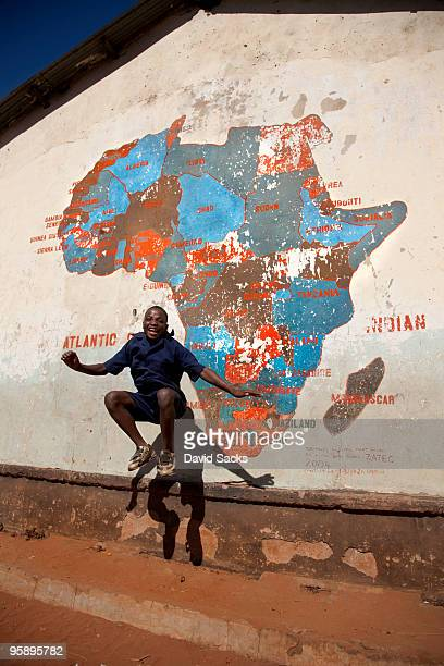 Boy in front of map of Africa