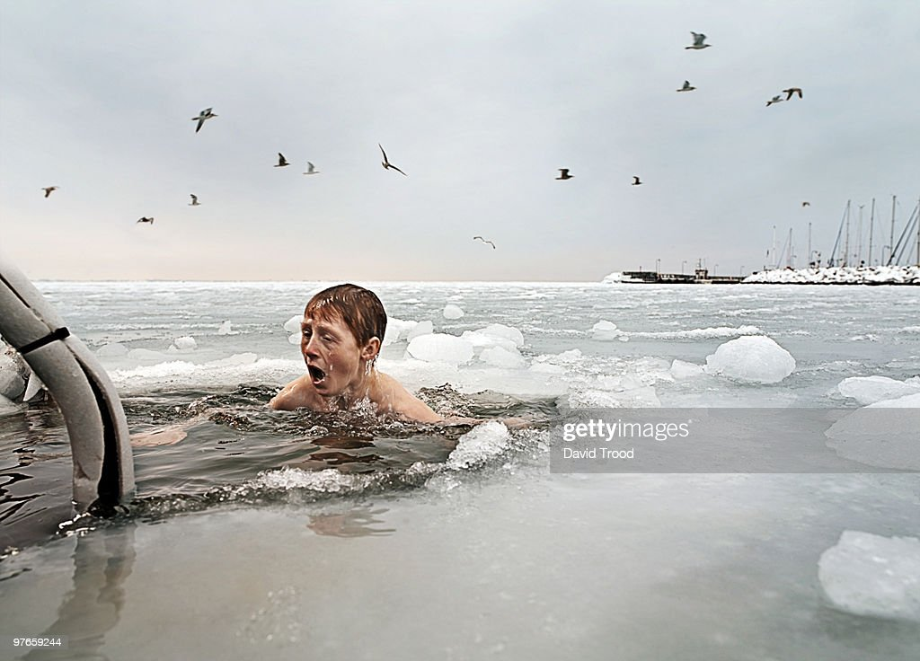 Boy in frozen sea. : Stock Photo