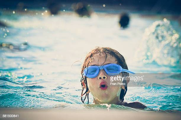 Boy in goggles at the pool