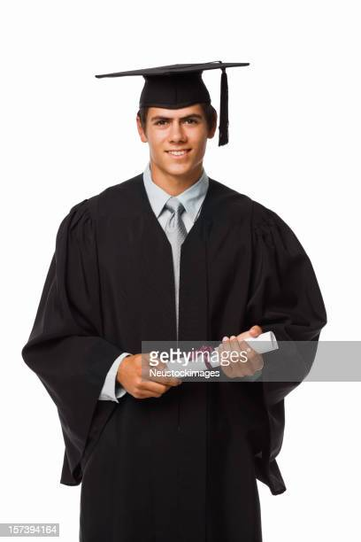 Boy in graduation robes holding a diploma