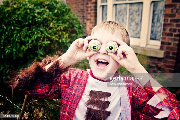 boy in halloween dress - naughty halloween stock photos and pictures