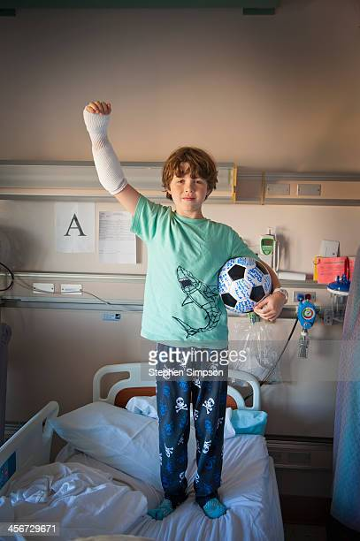 boy in hospital burn unit with soccer ball